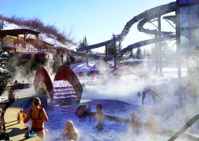 Steam rising off the warm pools outside on a snowy winter day.