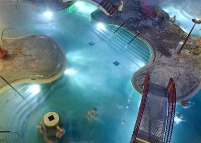 Night time view of outdoor pools.