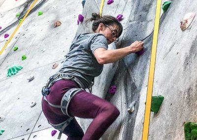 Women on rock wall.