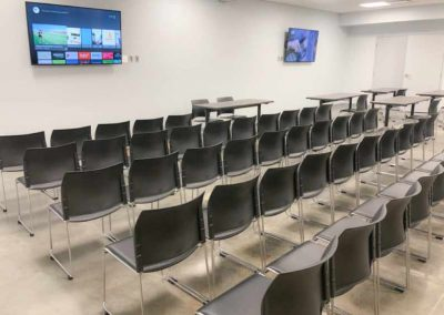 Indoor community room with chairs and tv's