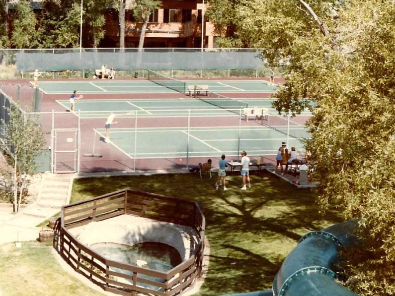Old tennis courts and heart shaped pool.