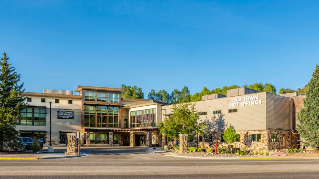 Exterior photo of Old Town Hot Springs on a blue bird day.